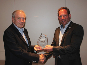 ESMAs Outgoing Chairman Jon Bultemeyer presents the inaugural Honourable Ambassador Award to Wilfried Kammann